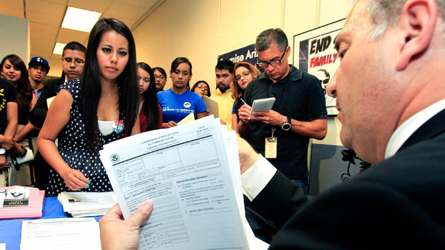 PHOTO: Gaby Perez, left, hands over all her paperwork to get guidance from immigration attorney Jose Penalosa, right, in Phoenix on August 15, 2012, for a new federal program, called Deferred Action, that would help some young undocumented immigrants avoi