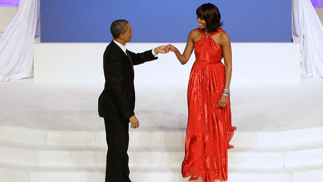 PHOTO: President Barack Obama greets first lady Michelle Obama as she arrives on stage during the Commander-In-Chief Inaugural ball at the Washington Convention Center during the 57th Presidential Inauguration Monday, Jan. 21, 2013 in Washington.