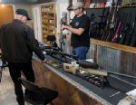 PHOTO: Clerk Lance McCoy, right, shows a variety of weapons Thursday, Dec. 20, 2012, including an AR-15 style semi-automatic at Kizer Guns and Ammo near Nacogdoches, Texas.