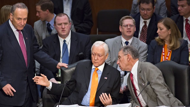 PHOTO: From left, Sen. Chuck Schumer, D-N.Y., standing, Sen. Orrin G. Hatch, R-Utah, and Sen. Chuck Grassley, R-Iowa, confer as the Senate Judiciary Committee meets on immigration reform on Capitol Hill in Washington, Thursday, May 9, 2013.