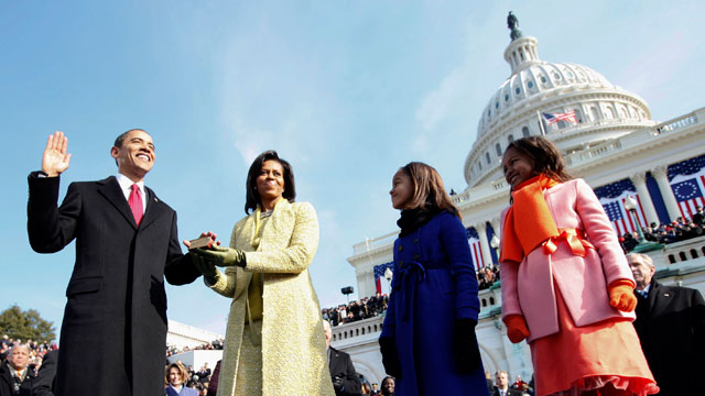 PHOTO: This Jan. 20, 2009 file photo shows Barack Obama, left, taking the oath of office from Chief Justice John Roberts, not seen, as his wife Michelle, holds the Lincoln Bible and daughters Sasha, right and Malia, look on at the Capitol in Washington.