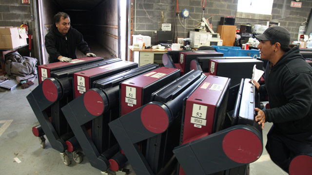 Walter Huancaya and his son, Jose, load up voting machines to be delivered to Bergenfield and Haworth Friday morning Nov. 2, 2012. Bergen County voting booths are leaving the distribution center to towns for Election Day.