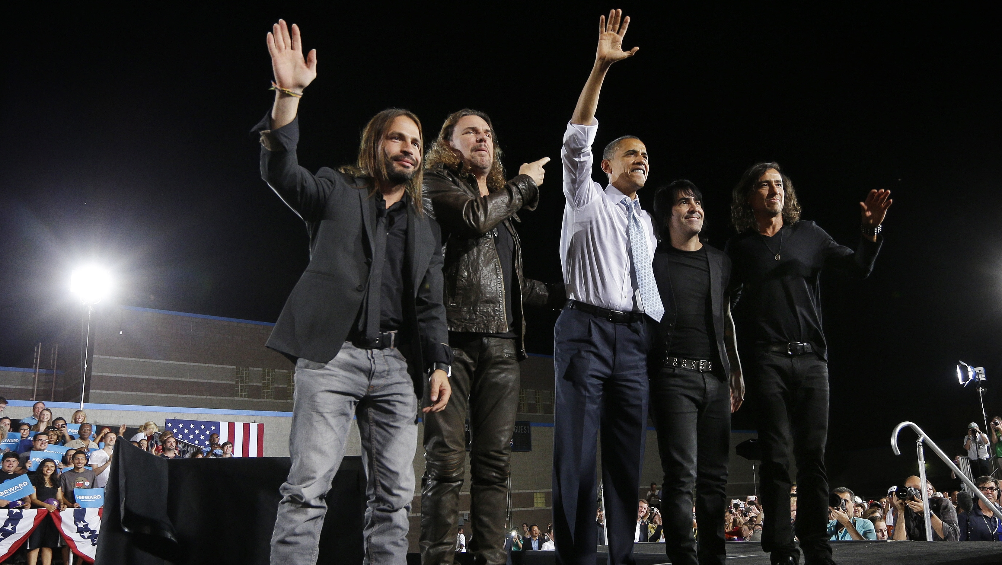 PHOTO: President Barack Obama, center, on stage with members of the Mexican Rock Band Mana, during a campaign event in Desert Pines High School, Sunday, Sept. 30, 2012 in Las Vegas.