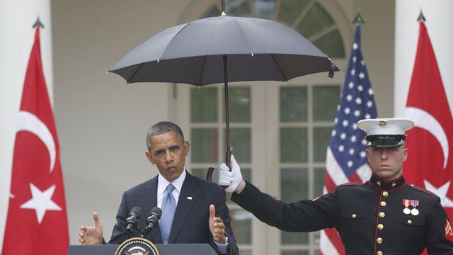 PHOTO: A Marine holds a umbrella as President Barack Obama speaks during his joint news conference with Turkish Prime Minister Recep Tayyip Erdogan, Thursday, May 16, 2013, in the Rose Garden of the White House in Washington.