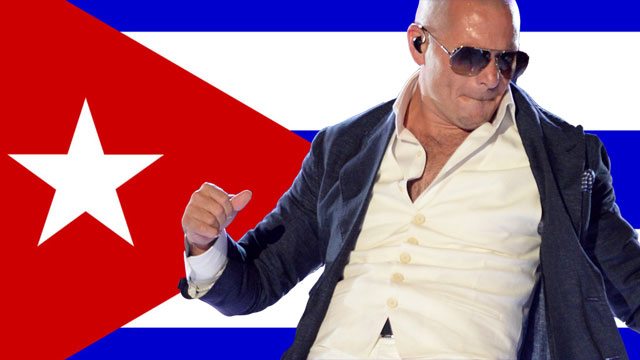 PHOTO: Pitbull performs at ACM Presents: Tim McGraws Superstar Summer Night at the MGM Grand Garden Arena on Monday, April 8, 2013, in Las Vegas. Cuban flag superimposed in the background.