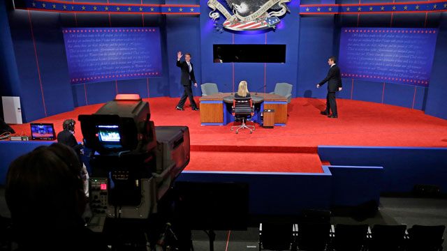 PHOTO:  Caption: Students posing as Vice President Joe Biden and his Republican challenger, Rep. Paul Ryan, R-Wis., walk on stage during set up for Thursdays vice presidential debate, Wednesday, Oct. 10, 2012, at Centre College in Danville, Ky.