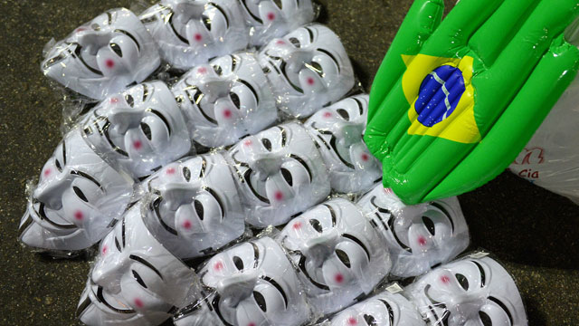 PHOTO:  Guy Fawkes masks are seen displayed for sale during a demonstration near the house of Rio de Janeiro governor Sergio Cabral in Leblon, Rio de Janeiro, Brazil.