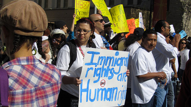 PHOTO: Immigration activists protest Georgias immigration law at a rally in 2011.