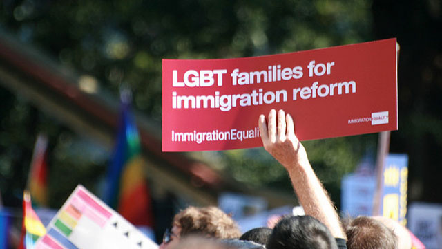 PHOTO: People call for equal rights for same-sex couples under immigration reform during an October 2009 rally in Washington, DC.