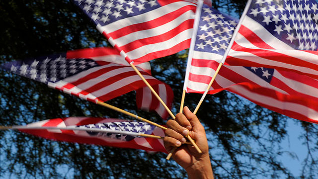 PHOTO: American flags are waved at a rally for immigration reform in Phoenix, Arizona in 2010. A bipartisan group of senators announced a framework for immigration reform in Washington, DC, in January 2013.