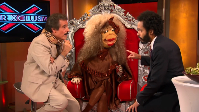 PHOTO: The Daily Shows Wyatt Cenac talks to the stars of Puerto Ricos most popular TV show, SuperXclusivo.