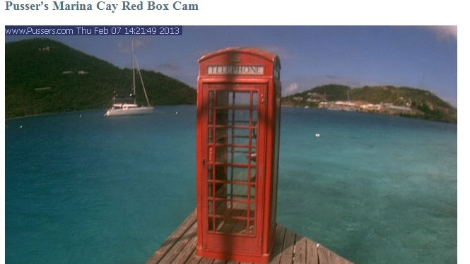PHOTO: Tourists are puzzled by the phone booth on the sea