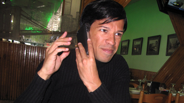 PHOTO: Gay rights activist Pedro Julio Serrano eats lunch in his neighborhood in Queens, New York, while conducting a radio interview with a media outlet in Puerto Rico.