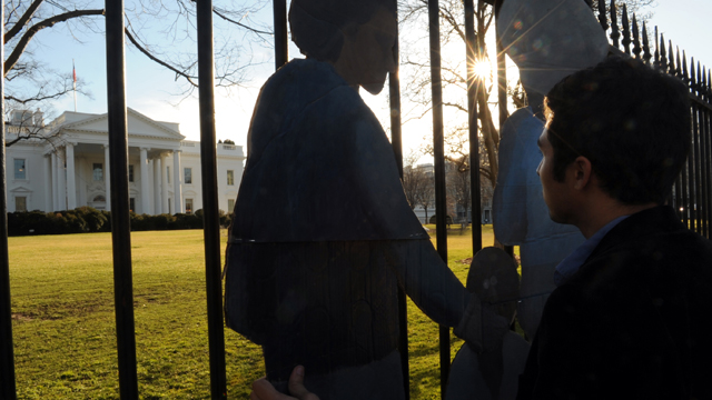 PHOTO: WASHINGTON, D.C., FEBRUARY 12, 2013: Protest artist Ramiro Gomez from Los Angeles arrives with his art work at the White House.
