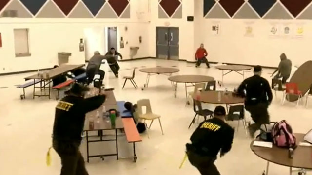 PHOTO:Members of Maricopa County Sheriff Joe Arpaios volunteer posse participate in a simulated school shooting on Saturday, Feb. 9, 2013 near Phoenix, Arizona.