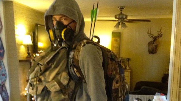 "PHOTO: A young man dressed in survivalist gear, ""bug-out bag"" and all."