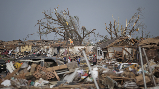 PHOTO:MOORE, OK - MAY 20: People assess the damage after a powerful tornado ripped through the area on May 20, 2013 in Moore, Oklahoma.
