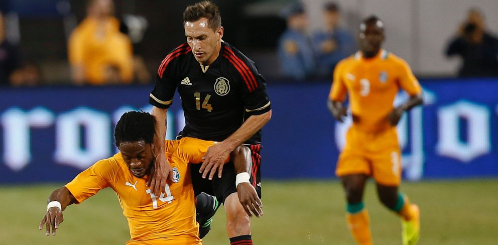 PHOTO: Christian Gimenez #14 of Mexico defends Jean-Jaques Gasso #14 of Ivory Coast during their match at MetLife Stadium on August 14, 2013 in East Rutherford, New Jersey.