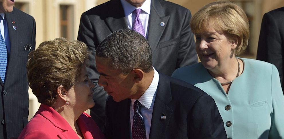 PHOTO: U.S. President Barack Obama gives a kiss hello to Brazils President Dilma Rousseff as they arrive for the family photo at the G20 summit on September 6, 2013 in Saint Petersburg.