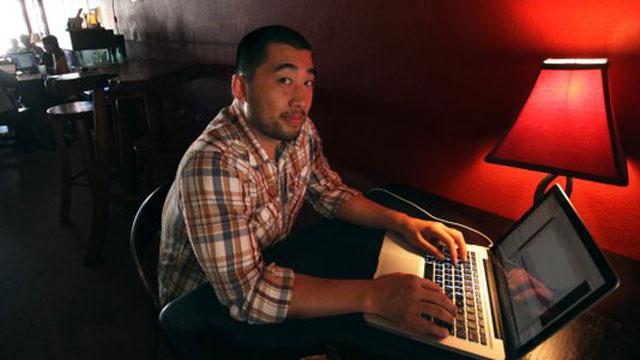 PHOTO:Tom Wong works in his favorite coffee shop in San Diegos North Park neighborhood.