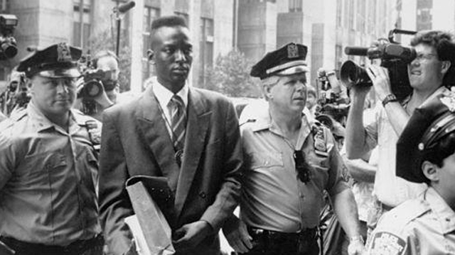PHOTO: One of the five defendants, Yusef Salaam walks into courthouse with police in The Central Park Five.