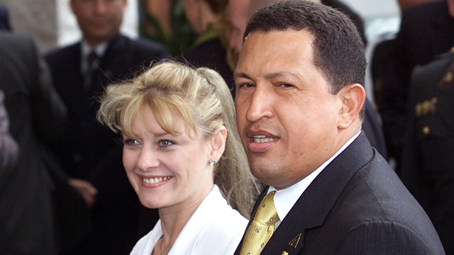 PHOTO: Hugo Chavez, the president for Venezuela, is accompanied by his then-wife Marisabel Rodriguez de Chavez, in the hotel where the inauguration XI Iberoamericana is, 23 November 2001, in Lima.