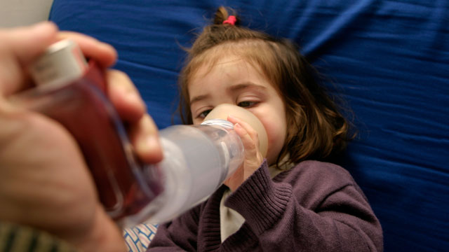 PHOTO:A young girl receives treatment for asthma. Health officials say ailments like asthma are linked to climate change.