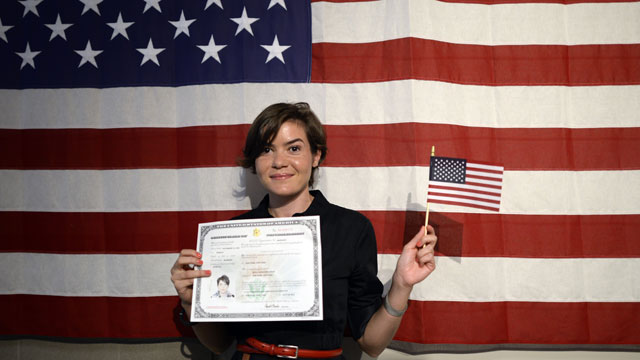 PHOTO: Irina Alexandra Tone holds her new citizenship documents following a naturalization ceremony July 2, 2013 in New York. 150 immigrants, as part of similar events nationwide to mark the July Fourth holiday to the oath of citizenship.