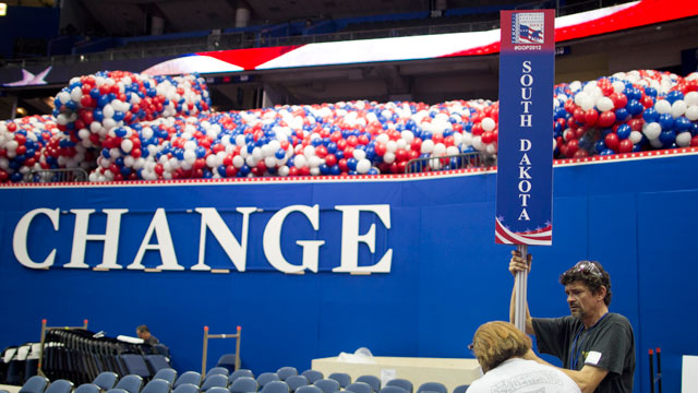 PHOTO:Workers set up state placards for delegates in preparation for the Republican National Convention (RNC) inside the Tampa Bay Times Forum in Tampa, Florida, U.S., on Friday, Aug. 24, 2012.