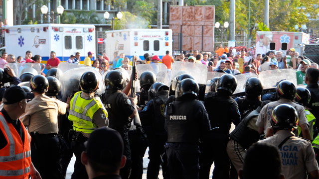 PHOTO:Members of the National Guard take shelter during a riot outside Uribana Prison in Barquisimeto, Lara state, Venezuela.