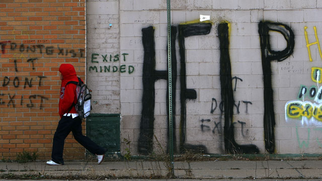 PHOTO:A pedestrian walks by graffiti on a downtown street November 20, 2008 in Detroit, Michigan. Detroit became the largest city in the United States to file for bankruptcy on Thursday, July 18, 2013.