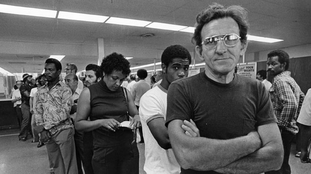 PHOTO:Unemployed autoworkers queuing at an unemployment office in Detroit, Michigan.
