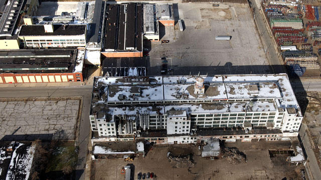 PHOTO:Only a few cars are parked in a lot near a closed factory on November 21, 2008 in Detroit, Michigan.