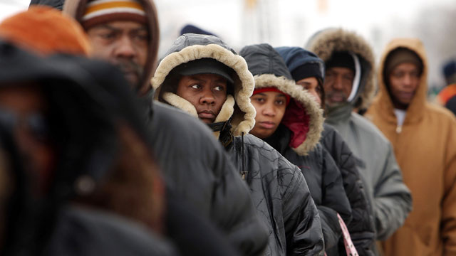 PHOTO:People wait in a several block line to receive gifts of food, personal care and household items and toys at the A Miracle in Motown event, part of a program to help working poor and disadvantaged families December 18, 2008 in Detroit, Michigan.