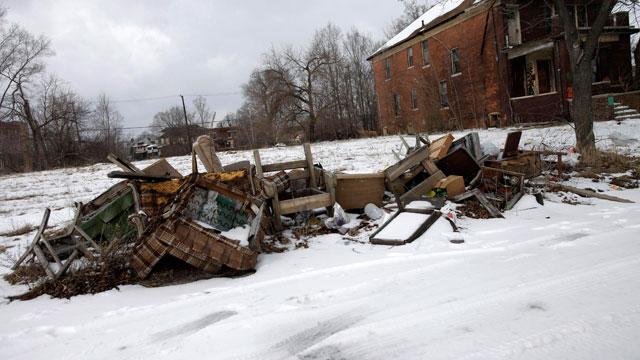 PHOTO:Trash is seen lying alongside a street February 24, 2013 in Detroit, Michigan.
