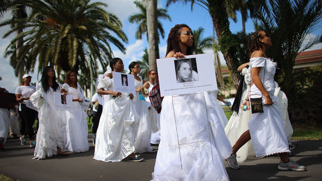 PHOTO: College students wear wedding gowns as they participate in the College Brides Walk from Barry University on February 8, 2013 in Miami Shores, Florida. The students walked six miles to raise awareness of the issue of domestic violence.
