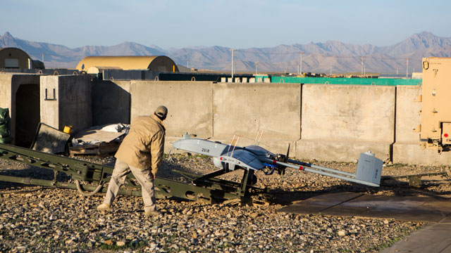 PHOTO: A civilian contractor checks on a US Army 14' Shadow surveillance drone set to be launched at Forward Operating Base Shank May 8, 2013 in Logar Province, Afghanistan. The Shadow drone is remotely controlled from a nearby cabin.