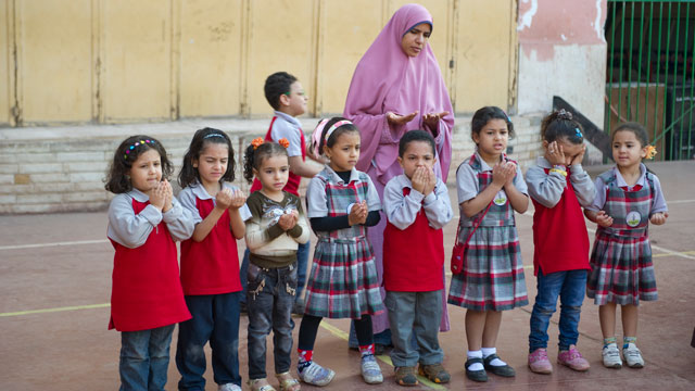 PHOTO:Primary school students recite morning prayers and salute the Egyptian flag during their morning routine in the playground at Al-Redwan Islamic School on November 8, 2012 in the Nasr City district of Cairo, Egypt.