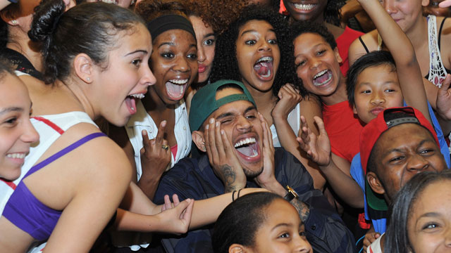 PHOTO:Chris Brown poses with excited fans during a visit to the Debbie Allen Dance Academy.