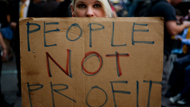 PHOTO:An Occupy Wall Street protester holds a sign during a demonstration in New York, U.S., on Monday, Sept. 17, 2012. The protest movement sparked a global revolt against economic inequality.