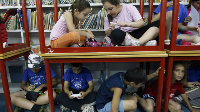 PHOTO:Israeli schoolchildren gather in a bomb shelter at a school in Jerusalem after sirens sounded across Israel as part of a massive civil defence exercise aimed at preparing the country for attacks involving non-conventional weapons on June 2, 2009.