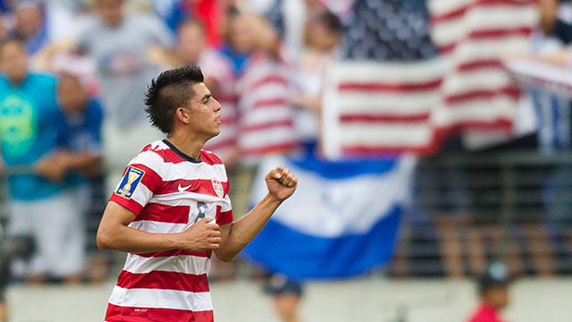 PHOTO: Joe Corona celebrates after scoring a goal against El Salvador in the first half of a CONCACAF quarterfinal match in Baltimore on July 21, 2013.