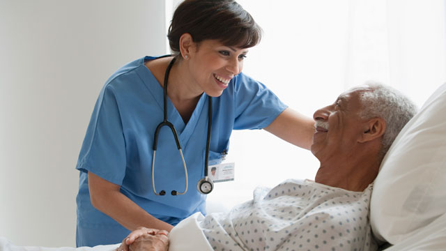 PHOTO:A Latina nurse assists a patient.