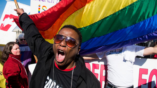 PHOTO:Cd Kirven, of Dallas, Texas, leads chants for marriage equality supporters as they rally in front of the Supreme Court before oral arguments in a case that will test the constitutionality of the Defense of Marriage Act on March 27, 2013.