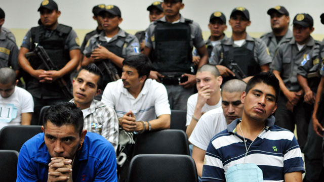 PHOTO:  Suspected members of the Mexican drug cartel Los Zetas from Guatemala and Mexico are guarded by police.