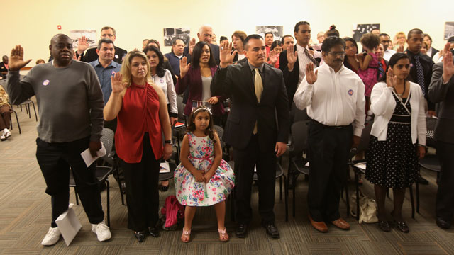 PHOTO:Immigrants take the oath of citizenship at a special Valentines Day naturalization ceremony for married couples on February 14, 2013 in Tampa, Florida.