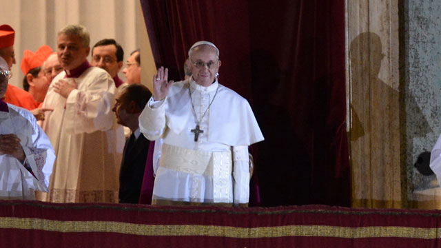 PHOTO:New Pope, Argentinian cardinal Jorge Mario Bergoglio appears at the window of St Peters Basilicas balcony after being elected the 266th pope of the Roman Catholic Church.