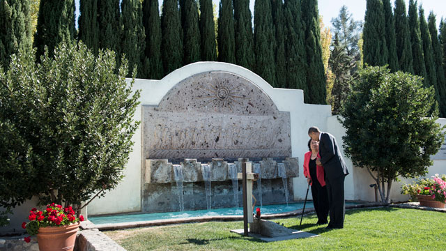 PHOTO: US President Barack Obama speaks with Helen F. Chavez at the grave of her husband Cesar Chavez during a tour of a memorial garden at the Chavez National Monument October 8, 2012 in Keene, California.