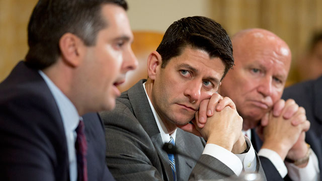 PHOTO: Rep. Kevin Brady (R-Texas), left to right, and Rep. Paul Ryan (R-Wisc.) listen as Rep. Devin Nunes (R-Calif.), left, questions witnesses during a House Ways and Means Committee hearing in Washington, D.C.