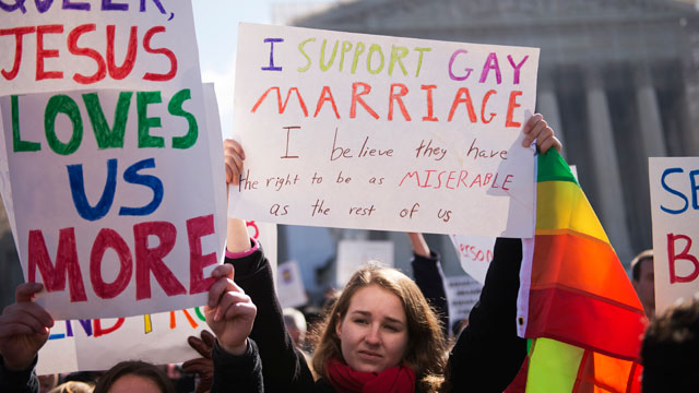 PHOTO:Amanda Smart of Georgetown University, holds a sign supporting gay marriage outside of the Supreme Court during opening arguments on the opposition to Californias Proposition 8 that bans gay marriage.